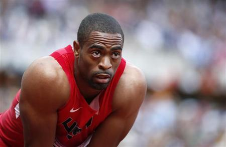 Tyson Gay of the U.S. checks his time after the men's 100m round 1 heats at the London 2012 Olympic Games at the Olympic Stadium August 4, 2012. REUTERS/Lucy Nicholson