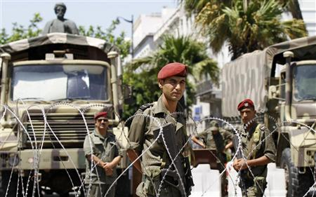 Tunisian soldiers stand guard during a protest of Tunis July 26, 2013. REUTERS-Anis Mili