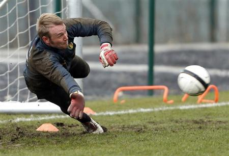 Belgium's national soccer team goalkeeper Jean-Francois Gillet dives for the ball during a training session in Brussels March 19, 2013. REUTERS/Francois Lenoir