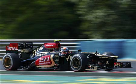 Lotus F1 Formula One driver Romain Grosjean of France drives during the third practice session of the Hungarian F1 Grand Prix at the Hungaroring circuit in Mogyorod, near Budapest July 27, 2013. REUTERS/Laszlo Balogh