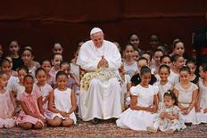 Pope Francis meets with children during an encounter with representatives of the civil society in the Municipal Theater in Rio de Janeiro, July 27, 2013. REUTERS/Carlo Wrede-Agencia O Dia