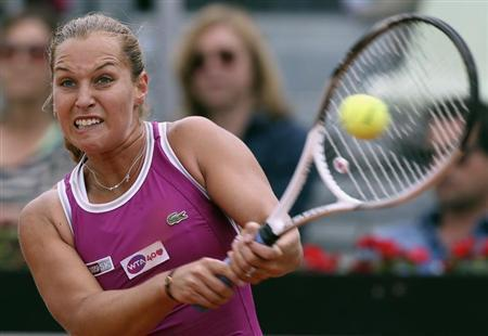 Dominika Cibulkova of Slovakia hits a return to Serena Williams of the U.S. during their women's singles match at the Rome Masters tennis tournament May 16, 2013. REUTERS/Alessandro Bianchi