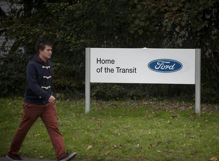 A man passes a sign outside the Ford Transit van factory in Southampton, southern England October 25, 2012. REUTERS/Kieran Doherty /Files
