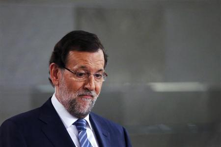 Spain's Prime Minister Mariano Rajoy looks on during a joint news conference with his Romanian counterpart Victor Ponta (unseen) after their meeting at Moncloa Palace in Madrid July 22, 2013. REUTERS/Juan Medina