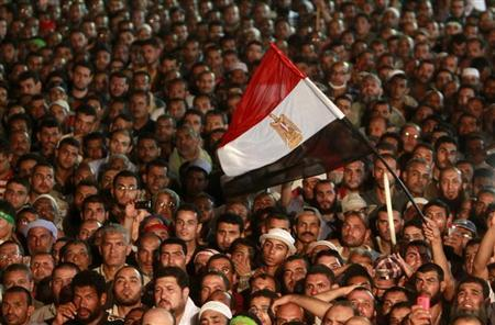 Supporters of deposed Egyptian President Mohamed Mursi take part in a protest at the Rabaa Adawiya square, where they are camping, in Cairo July 27, 2013. REUTERS/Mohamed Abd El Ghany