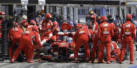 Ferrari Formula One driver Fernando Alonso of Spain makes a pitstop during the Hungarian F1 Grand Prix at the Hungaroring circuit in Mogyorod, near Budapest July 28, 2013. REUTERS/Luca Bruno/Pool