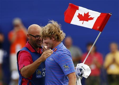 Brandt Snedeker of the U.S. celebrates with his caddy Scott Vail (L) of Canada after winning during the final round at the Canadian Open golf tournament at the Glen Abbey Golf Club in Oakville July 28, 2013. REUTERS/Mark Blinch