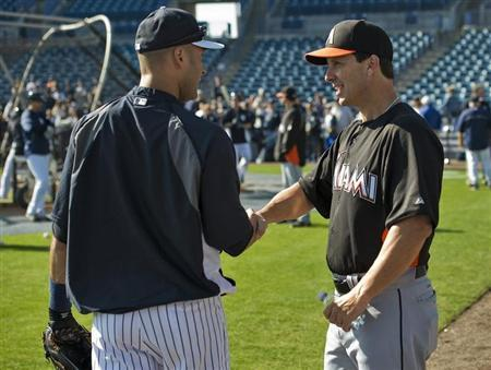 Florida Marlins hitting coach Tino Martinez (R) talks with New York Yankees shortstop Derek Jeter (L) before a MLB spring training baseball game in Tampa, Florida, March 15, 2013. REUTERS/Steve Nesius