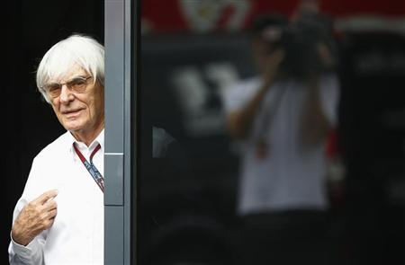 F1 commercial supremo Bernie Ecclestone looks out of his motor home after the second practice for the German F1 Grand Prix at the Nuerburgring racing circuit July 5, 2013. REUTERS/Kai Pfaffenbach/Files