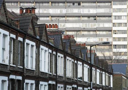 A terraced row of houses is pictured in front of a residential tower block in London January 16, 2009. REUTERS/Luke MacGregor