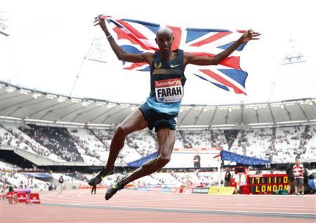 Mo Farah of Britain clicks his heels after winning the men's 3000m at the London Diamond League 'Anniversary Games' athletics meeting at the Olympic Stadium, in east London July 27, 2013. REUTERS/Andrew Winning