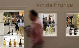 A visitor walks past wine bottles displayed at Vinexpo, the world's biggest wine fair, in Bordeaux, southwestern France, June 18, 2013. REUTERS/Regis Duvignau