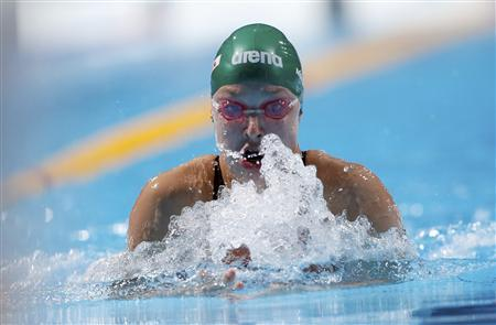 Ruta Meilutyte of Lithuania competes in the women's 100m breaststroke heats during the World Swimming Championships at the Sant Jordi arena in Barcelona July 29, 2013. REUTERS/Albert Gea