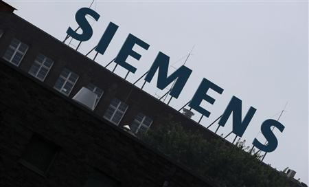 The logo of Siemens AG is seen atop a factory in Berlin July 29, 2013. REUTERS/Fabrizio Bensch