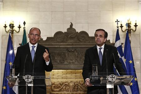Italy's Prime Minister Enrico Letta (L) addresses reporters during a joint news conference with his Greek counterpart Antonis Samaras in Athens July 29, 2013. REUTERS/Yorgos Karahalis