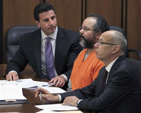 Ariel Castro (C), 53, listens to the judge as he sits between his attorneys Jaye Schlachet (R) and Craig Weintraub in the courtroom in Cleveland, Ohio July 26, REUTERS/Aaron Josefczyk