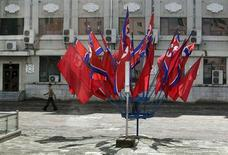 A man walks past North Korean national flags in Pyongyang July 29, 2013. REUTERS/Jason Lee