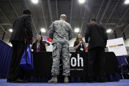 Jobseekers talk to recruiters from Yoh, a staffing agency, during a Hire Our Heroes job fair targeting unemployed military veterans and sponsored by the Cable Show, a cable television industry trade show in Washington, June 11, 2013. REUTERS/Jonathan Ernst