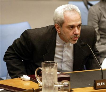 Iran's ambassador to the United Nations M. Javad Zarif rises from the desk after addressing a Security Council meeting on the situation in Iraq at the U.N. in New York on October 16, 2002. REUTERS/Ray Stubblebine