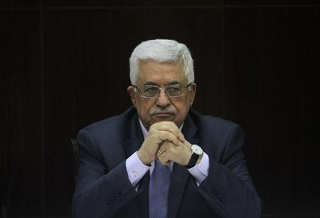 Palestinian President Mahmoud Abbas heads a Palestinian cabinet meeting in the West Bank city of Ramallah July 28, 2013. REUTERS/Issam Rimawi/Pool