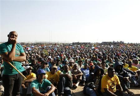 Members of the mining community look on as they are addressed by their leaders during a strike at Lonmin's Marikana platinum mine in Rustenburg, 100 km (62 miles) northwest of Johannesburg, May 15, 2013. REUTERS/Siphiwe Sibeko
