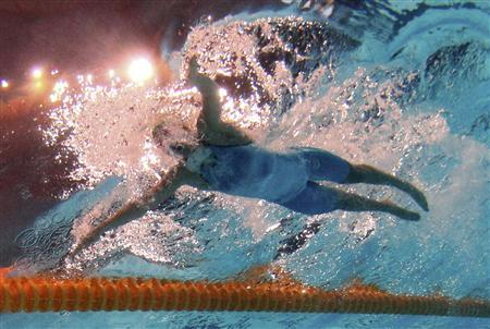 Lithuania's Ruta Meilutyte is seen underwater as she swims in the women's 100m breaststroke final during the World Swimming Championships at the Sant Jordi arena in Barcelona July 30, 2013. REUTERS/Michael Dalder