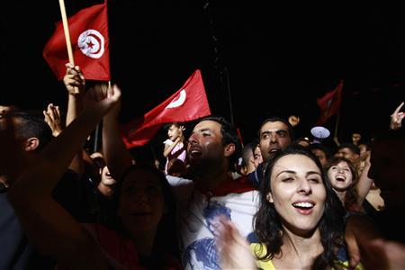 People waving Tunisian flags gather during a protest to demand the ouster of the Islamist-dominated government, outside the Constituent Assembly headquarters in Tunis July 29, 2013. REUTERS/Anis Mili