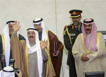 Emir Sheikh Sabah al-Ahmad al-Sabah (L) waves as he finishes opening the 14th session of Parliament in Kuwait City December 16, 2012. REUTERS/Stephanie Mcgehee