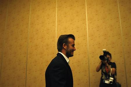 Former soccer player David Beckham arrives for a meet and greet session with students from the Guardian Academy and the Singapore Association of the Deaf's affiliated schools at Marina Bay Sands in Singapore July 7, 2013. REUTERS/Edgar Su