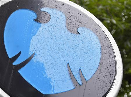 Raindrops are seen on the logo of a Barclays bank in central London July 30, 2013. REUTERS/Toby Melville