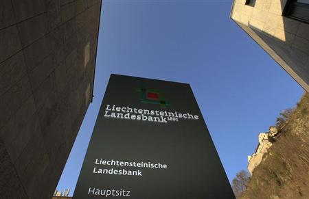 A sign marks the entrance of the headquarters of the Liechtensteinische Landesbank bank as Vaduz Castle is seen beside in the country's capital Vaduz March 14, 2012. REUTERS/Arnd Wiegmann