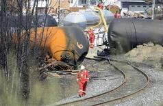 A worker walks near the railway track on the site of the train wreck in Lac Megantic, July 16, 2013. REUTERS/Ryan Remiorz/Pool