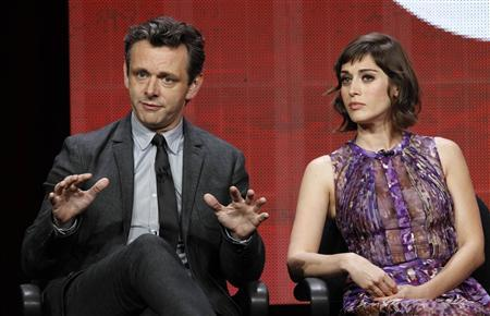 Cast member Michael Sheen speaks next to co-star Lizzy Caplan at a panel for the television series ''Masters of Sex'' during the Showtime portion of the Television Critics Association Summer press tour in Beverly Hills, California July 30, 2013. REUTERS/Mario Anzuoni
