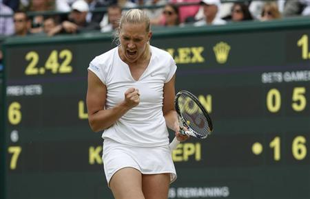 Kaia Kanepi of Estonia celebrates after defeating Laura Robson of Britain in their women's singles tennis match at the Wimbledon Tennis Championships, in London July 1, 2013. REUTERS/Eddie Keogh