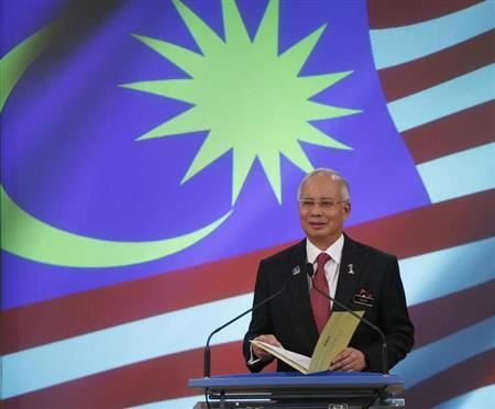 Malaysia's Prime Minister Najib Razak speaks during the announcement of his new cabinet ministers lineup at his office in Putrajaya outside Kuala Lumpur May 15, 2013. REUTERS/Bazuki Muhammad