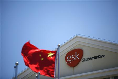 A Chinese national flag flutters in front of a GlaxoSmithKline (GSK) office building in Shanghai, in this July 12, 2013 file photo. The detention by Chinese authorities of a British corporate investigator and his American wife in the wake of a corruption probe into pharmaceutical giant GlaxoSmithKline has had a chilling effect on other risk consultants working in China. REUTERS/Aly Song/Files