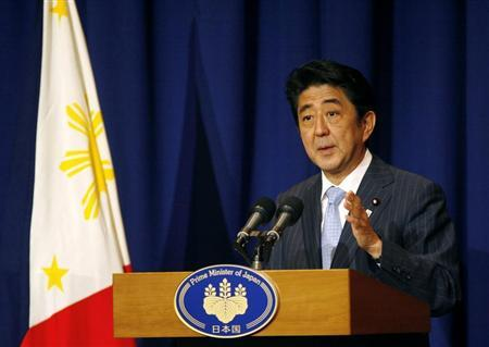 Japan's Prime Minister Shinzo Abe gestures during a news conference at a hotel in Makati city, metro Manila July 27, 2013. REUTERS/Al Falcon