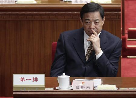 China's Chongqing Municipality Communist Party Secretary Bo Xilai pauses during the opening ceremony of the National People's Congress (NPC) at the Great Hall of the People in Beijing in this March 5, 2012 file photo. REUTERS/Jason Lee/Files