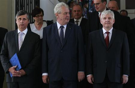 Czech President Milos Zeman (C), Prime Minister Jiri Rusnok and Minister of Finance Jan Fischer (R) pose for a group photo after the cabinet's inauguration at Prague, Castle July 10, 2013. REUTERS/Petr Josek