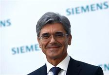 Newly elected Siemens CEO Joe Kaeser arrives for a news conference in Germany's Siemens AG headquarter in Munich July 31, 2013. REUTERS/Michaela Rehle