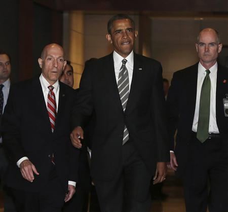 U.S. President Barack Obama (C) arrives for a meeting with House Democrats at the Capitol Visitor's Center in Washington July 31, 2013. REUTERS/Gary Cameron