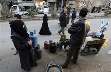 A man selling petrol and gas waits for clients in Ain Tarma neighbourhood, Damascus January 23, 2013. REUTERS/Goran Tomasevic