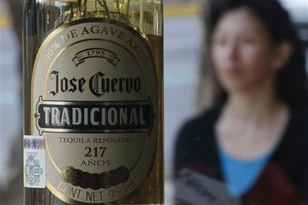 A bottle of Jose Cuervo Tequila rests on a shelf in Mexico City December 11, 2012. REUTERS/Edgard Garrido