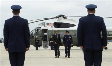 U.S. President Barack Obama (C) departs Joint Base Andrews in Maryland September 4, 2012, for a campaign trip to Norfolk, Virginia. REUTERS/Gary Cameron