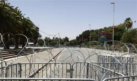 The capital's central Bardo square, where Tunisia's Constituent Assembly is located, is seen sealed off by the army with barbed wire and fencing in Tunis July 29, 2013. REUTERS/Anis Mili