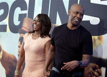 Actor Denzel Washington and his wife Pauletta Washington arrive for the premiere of the movie ''2 Guns'' in New York, July 29, 2013. REUTERS/Carlo Allegri