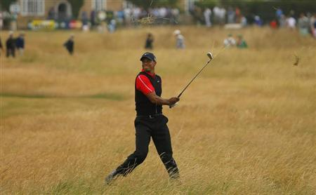 Tiger Woods of the U.S. hits out of the rough on the tenth hole during the final round of the British Open golf championship at Muirfield in Scotland July 21, 2013. REUTERS/Brian Snyder