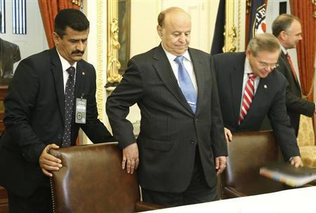 Yemeni President Abd Rabbu Mansour Hadi (C) takes his seat to meet with Senate Foreign Relations Committee Chairman Robert Menendez (D-NJ) (L) at the U.S. Capitol in Washington July 31, 2013. REUTERS/Jonathan Ernst