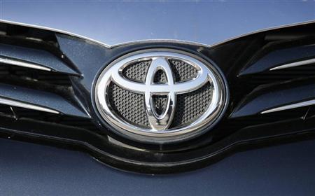The Toyota logo is seen on a car at Motorcity Toyota dealership in Rome October 10, 2012.REUTERS/Max Rossi