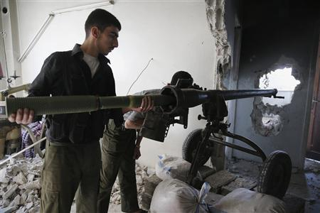 A Free Syrian Army fighter positions a cannon inside a house in Jobar, Damascus July 30, 2013. Picture taken July 30, 2013. REUTERS/ Mohamed Abdullah